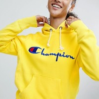 Champion Hoodie With Script Chest Logo at asos.com