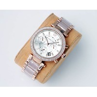 MK Fashion Men Women's Classic mechanical watch diamond men and women waterproof quartz watch