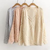 New fall crocheted hollow long-sleeved knit cardigan sweater coat was thin woman