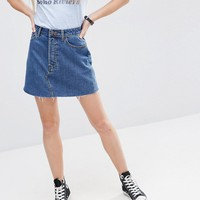 ASOS Denim High Waisted Mini Skirt with Raw Hem in Midwash Blue at asos.com
