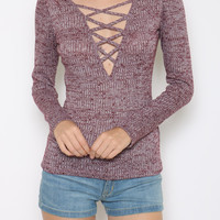 This soft mixed burgundy/white combo ribbed knit top features plunging v-neckline with none adjustable criss-cores lace up detailing, long sleeves. pair with pleated leatherette mini skirt, thigh high socks, Jeffrey Campbell Bad-Girl Booties and floppy hat