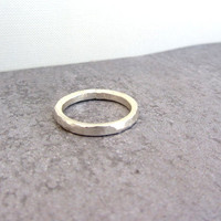 Simple hammered textured sterling silver stack band ring.