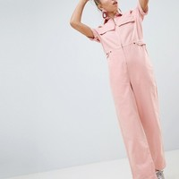 ASOS DESIGN denim boilersuit in pale pink at asos.com