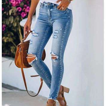 Fashionable stretch jeans with holes