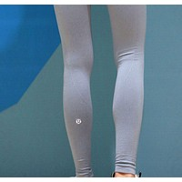 LULULEMON pure color all-around all-around running yoga workout pants with long legs and a seamless nine-point leg. Grey