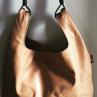 Genuine lambskin leather bag, so soft and unique.The Keeper is generously sized,designer handbag/purse.Classic,roomy and classy,oozes style.