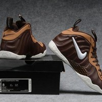 DCCK Air Foamposite Pro Bronze/White Shoe