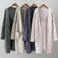 Solid color two - pocketed hollow knit cardigan jacket female