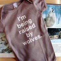 Baby Onesuit I'm Being Raised By Wolves 612mo by eggagogo on Etsy