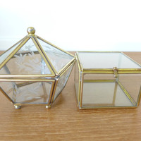 Two glass and brass boxes one square and one domed pentagon