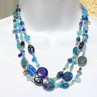 Necklace, beaded in shades of Mostly Blue, three strands