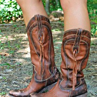 Our Redneck Revival Leather Boots by Liberty Black are AMAZING! They are made from Delano Cotto Acabado Tambor Genuine Leather that is luxuriously soft . They have detailed side straps with knotted leather strip fringe, round toe & a broken in look.