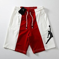 AJ AIR JORDAN Flying man big LOGO color matching men and women casual sports shorts F0564-1 Red
