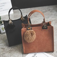 Suede Leather handbag with fur ball