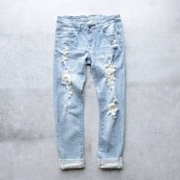 rocket destroyed cropped jeans - light wash denim