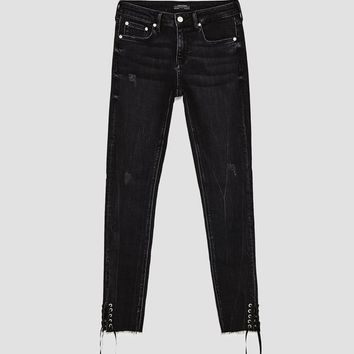 THE SKINNY LACE-UP ROSTOV JEANS