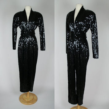 1980's black sequin jumpsuit w long sleeves and matching belt deep plunging V shaped bust matching belt w shoulder pads Night line medium 8