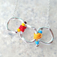 Spring 2014 Collection Silver Ring Necklace with Red and Yellow Cords
