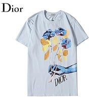 Dior Summer New Letter Floral Hand Print Women Men Top T-Shirt Light Blue