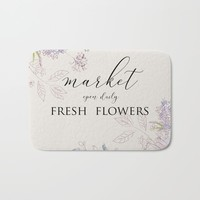 fresh flower market Bath Mat by sylviacookphotography