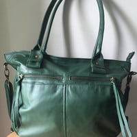 Handmade real leather shoulder bag.Perfect everyday bag or laptop work bag.Handles and crossbody strap with clips,pockets and compartments