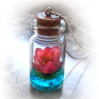 Lotus flower on a magic lake bottle necklace by UraniaArt on Etsy