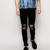 Religion | Religion Noize Skinny Fit Black Jeans with Cut Outs at ASOS