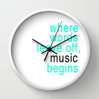 Where words leave off, music begins typography Wall Clock by productoslocos | Society6