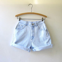 80s light wash jean shorts. high waisted shorts. roll up shorts.