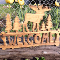 Moose welcome sign, rustic wooden cabin, lodge, or country home decor