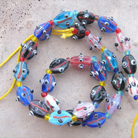 Fluted Oval Murano Glass abstract beads 16 inch strand