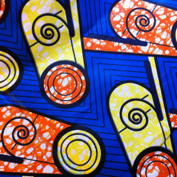 African Wax Print Fabric by the HALF YARD.  Spirals of yellow, royal blue and orange.