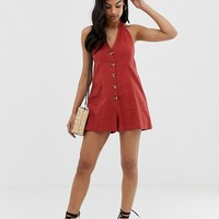 ASOS DESIGN halter romper with button detail in self stripe | ASOS
