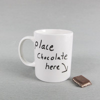 Handy mug with a nice place for chocolate