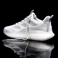 New fly woven casual sports men's shoes popcorn bottom breathable lightweight running coconut shoes