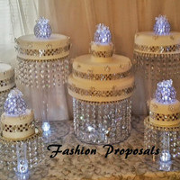 Wedding Cake Stand Cascade waterfall pure crystal  set of 9 wedding cake stands with a battery operated LED light.