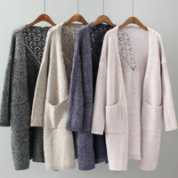 Solid color two pocket long hollow knitted cardigan jacket