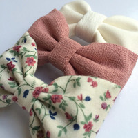 Winter white, textured mauve, and vintage floral hair bow set from Seaside Sparrow. These hair bows make a perfect gift for her.