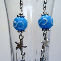 Dangling earrings with lampwork beads and starfish and hypo allergic ear wires.