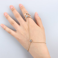 Statement double spade ring finger bracelet with crystal stone