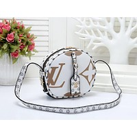 """LV"" Louis Vuitton fashion printed round cake asual trend slanting shoulder bag White"