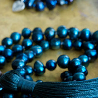 Long beaded tassel necklaces Deep blue and teal pearls Bohemian beaded mala necklace Om charms Heart charms Hippie chic Boho luxe pearls