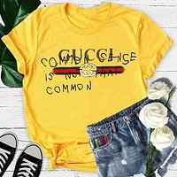 GUCCI street fashion men and women models graffiti letters loose wild half sleeve t-shirt Yellow