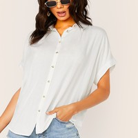 Dip Hem Button Front Cuffed Sleeve Shirt