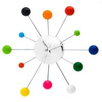 Online Interior Design | Injecting bold lavish shades to the interior walls in the shape of different sized chrome-plated arms each offering a bold and striking colour that represents the hour mark, the Spider Mixed Wall Clock from Karlsson offers a mod