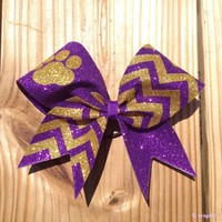 Purple and gold chevron print bow with paw.