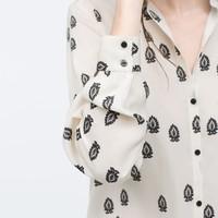 Contrasting printed blouse
