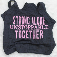 Strong alone unstoppable together tank top with pink writing