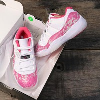 "Air Jordan 11 Low WMNS ""Pink Snakeskin"""