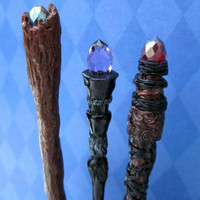 Dollhouse miniature Wizard's Magic Staff in deepest black with a pale purple crystal